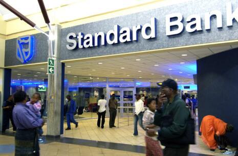 标准银行警告称中期利润可能减半